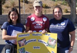 Western veterinary students holding Prop 2 poster