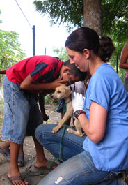 Dr. Simonsen treating a puppy in Nicaragua