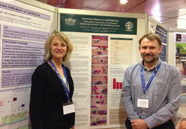 Drs. Krebsbach and Jones in front of the HSI bull fighting poster at the 2013 UFAW symposium