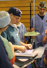 Dr. Breckenridge demonstrates suturing techniques for veterinary students