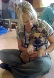 Volunteer Sarah Bruckenberger with a German shepherd puppy