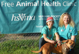 Ada Norris and Darci Adams with a canine RAVS patient