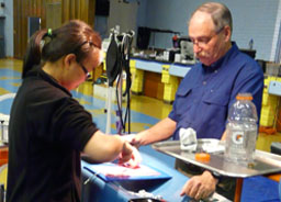 Dr. Paul Breckenridge provides guidance to a veterinary student practicing suturing
