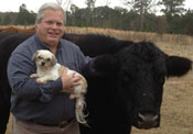 Dr. William Mangham with dog, Emma, and steer, Jack